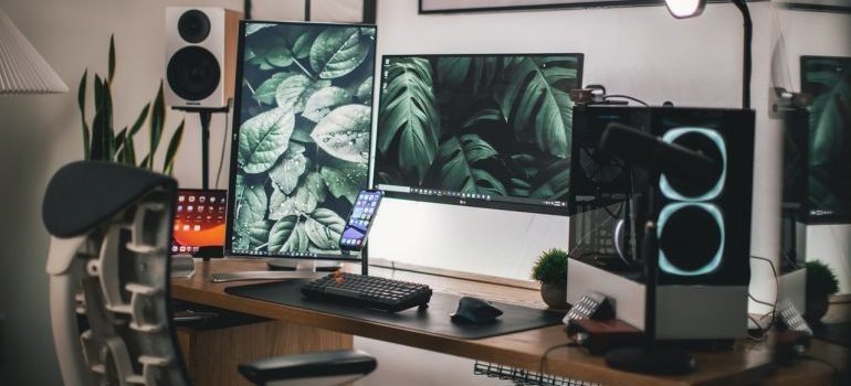 Gaming room with two monitors and computer on the desk