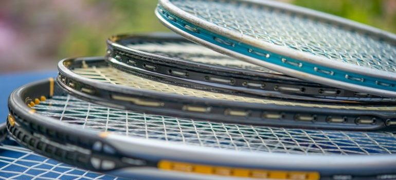 tennis rackets stacked