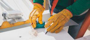 a man measuring cargo