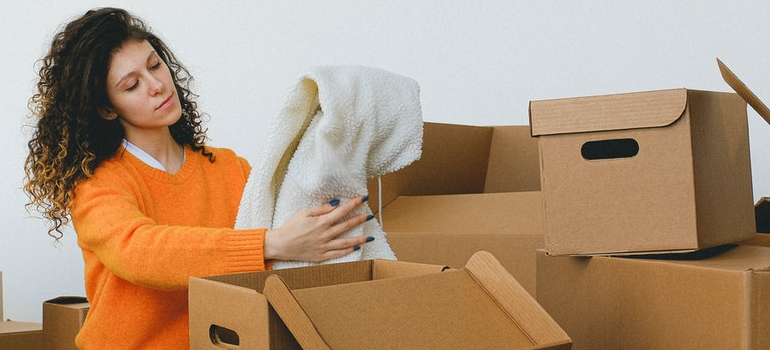 A woman packing for the move