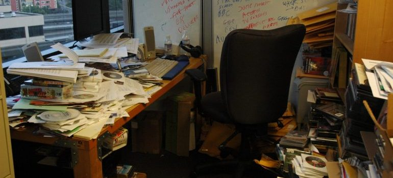 a messy desk - ways to organize your paperwork