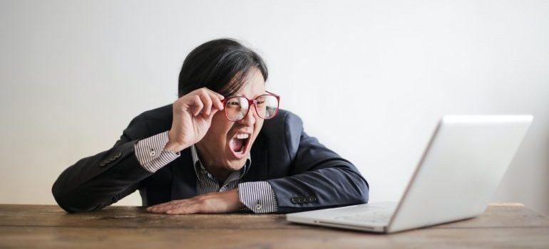 Man yelling at a laptop