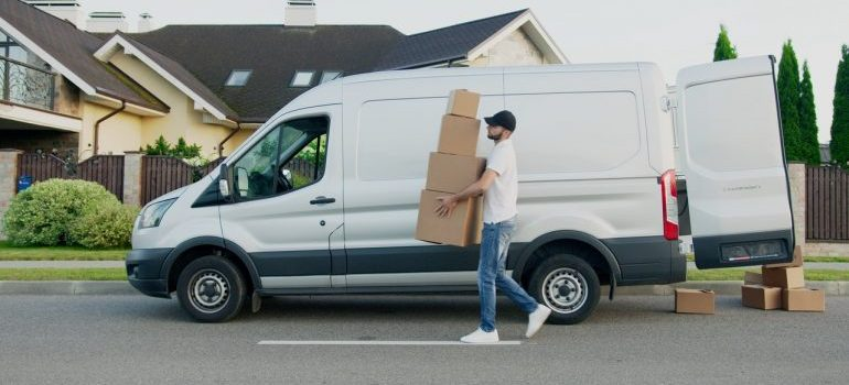 A guy who carries boxes and works for a moving company.