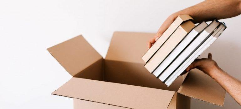 Packing books in a cardboard box