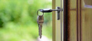 a key in the lock of a door