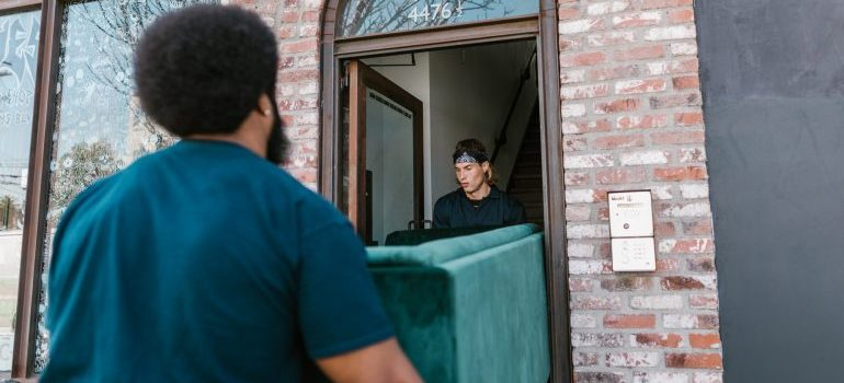 Movers carry furniture