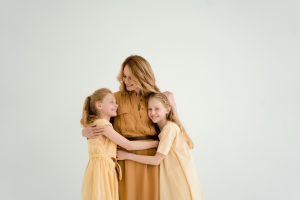 Mother with twin daughters