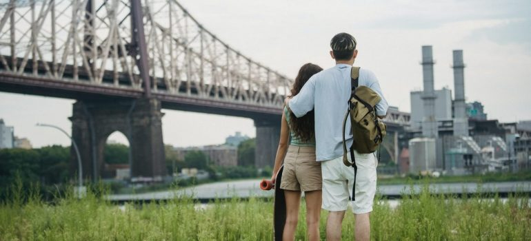 a couple hugging after viewing Brooklyn from afar as a way to adjust to Brooklyn after moving from the suburbs